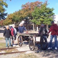 moving the baggage cart over the tracks